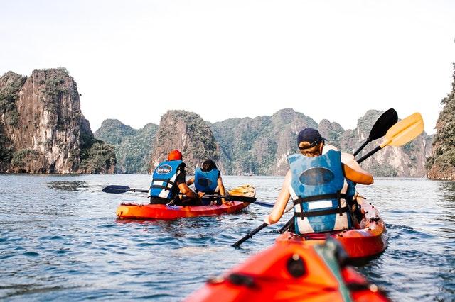 3 Set Of Kayakers Kayaking