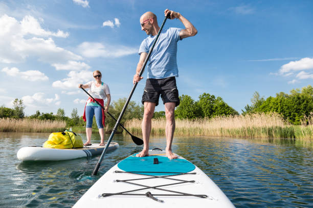 Couple on stand up paddle board on the lake